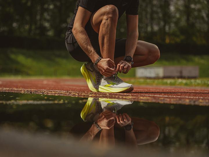 Man tying his running shoes