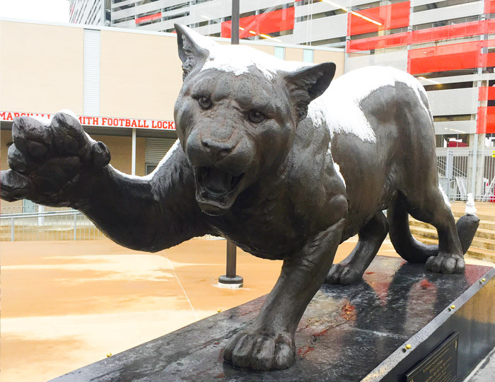 Cougar statue with snow.