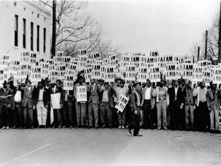 Photo of men holding signs