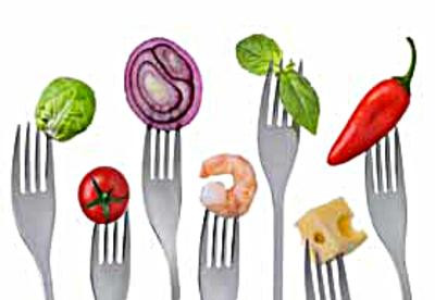 fresh healthy balanced food on forks isolated on a white background